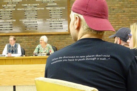 A member of the Bucyrus High School Xband watches an April 2019 Bucyrus City Council meeting. Xband members were recognized during the meeting for the band's achievements.