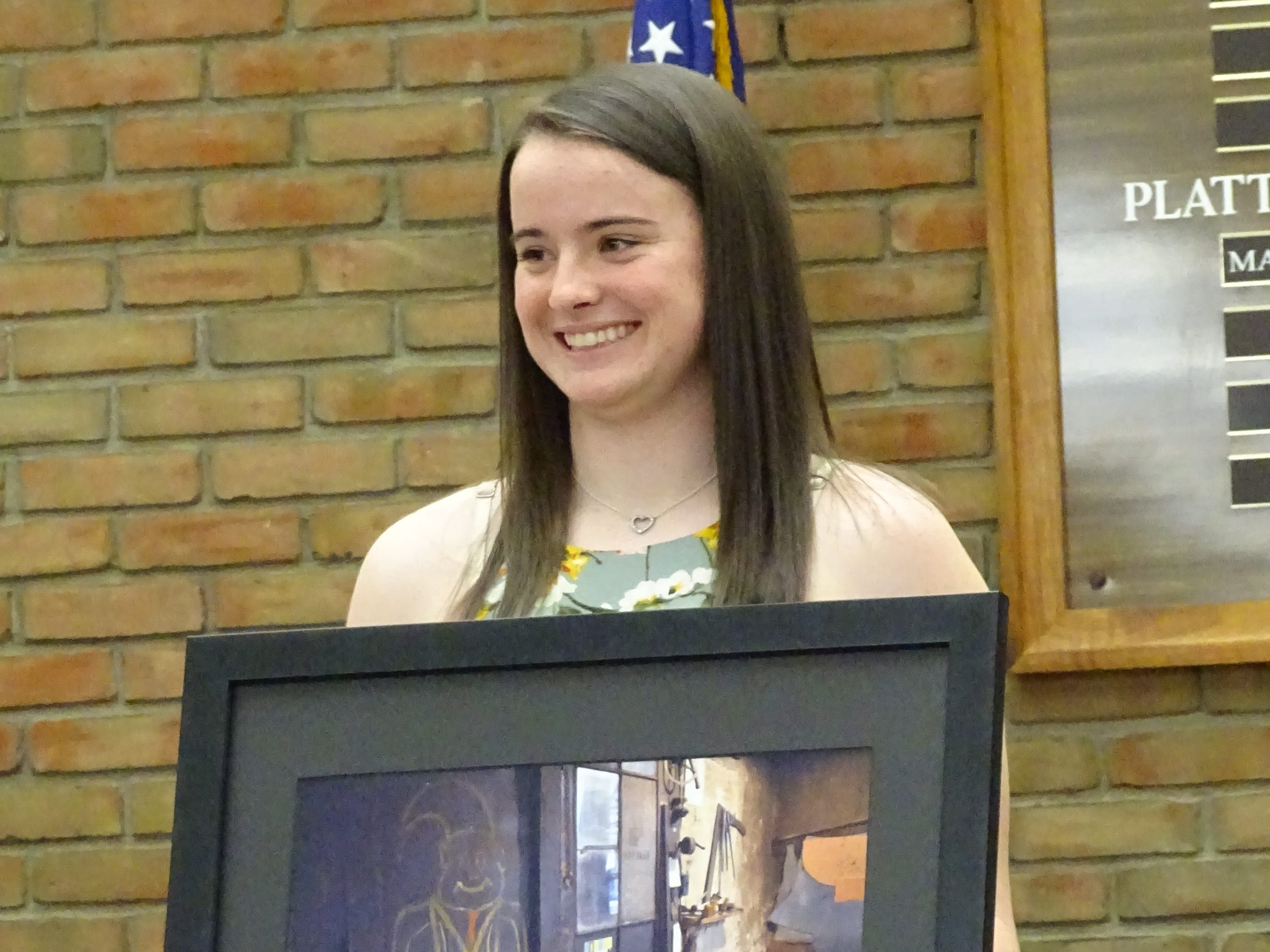 Caleigh Rister is honored during Tuesday night's Bucyrus City Council meeting.