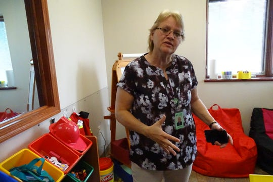 Cindy Wallis shows off Community Counseling's play therapy room on Wednesday. Wallis was named Community Counseling's executive director earlier this year.