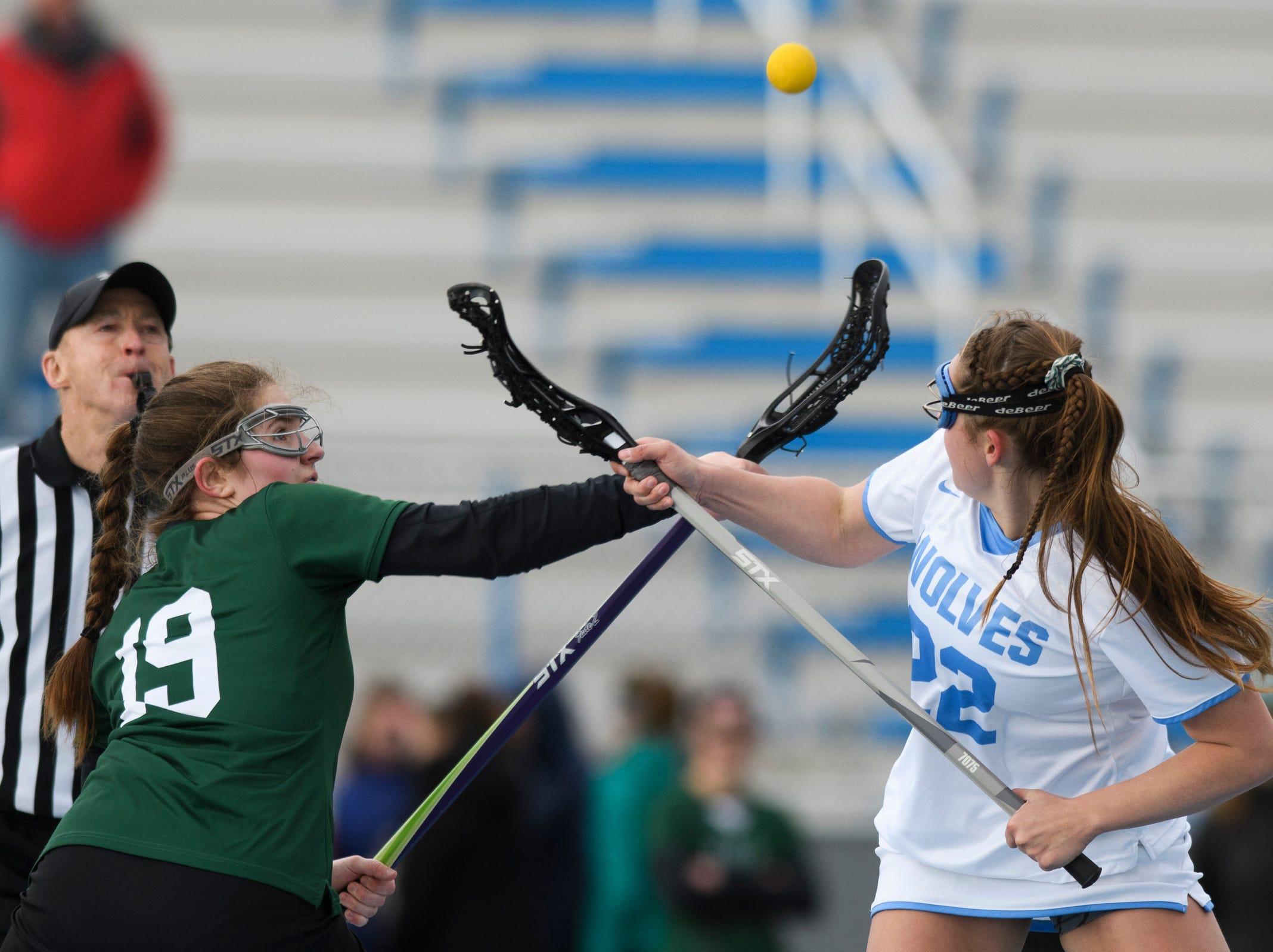 Rice's Sarah Holmes (19) and South Burlington's Sabrina Redzic (22) battle for the tip off during the girls lacrosse game between the Rice Green Knights and the South Burlington Wolves at South Burlington High School on Tuesday afternoon April 16, 2019 in South Burlington, Vermont.