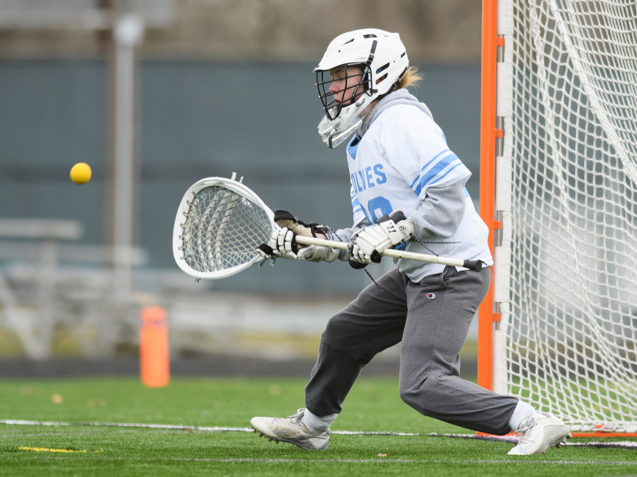 South Burlington goalie Claire Phillips (00) makes a save during the girls lacrosse game between the Rice Green Knights and the South Burlington Wolves at South Burlington High School on Tuesday afternoon April 16, 2019 in South Burlington, Vermont.