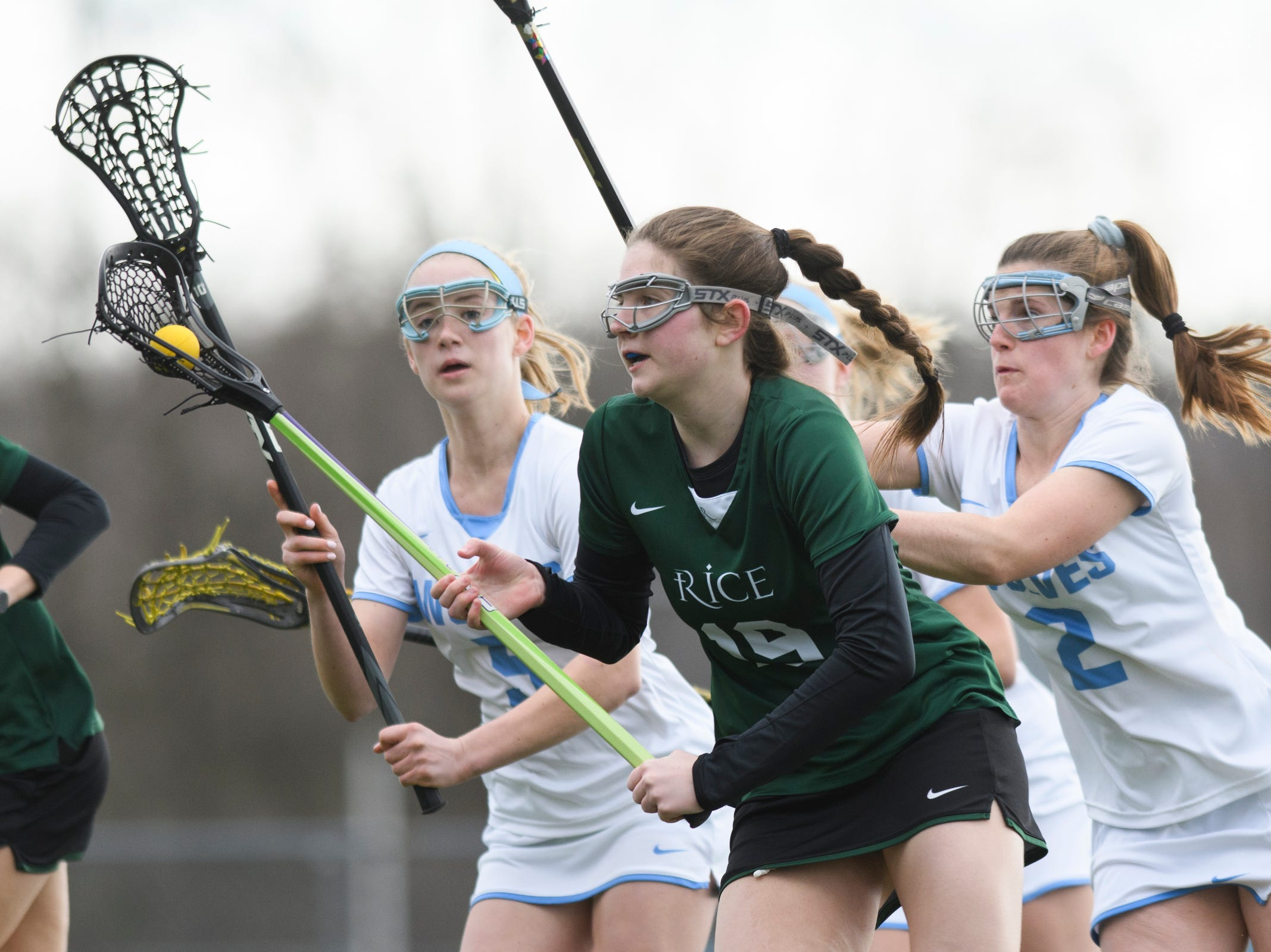 Rice's Sarah Holmes (19) runs down the field with the ball during the girls lacrosse game between the Rice Green Knights and the South Burlington Wolves at South Burlington High School on Tuesday afternoon April 16, 2019 in South Burlington, Vermont.