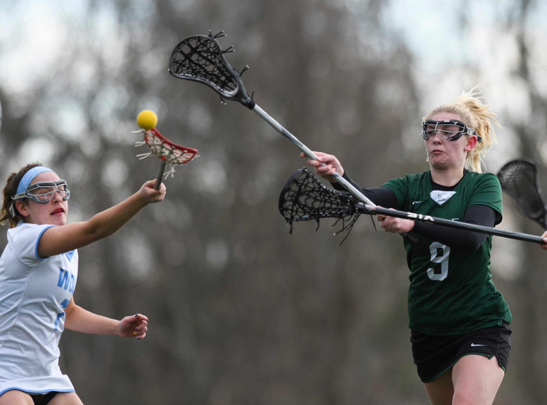 Rice's Alex Dostie (9) shoots the ball during the girls lacrosse game between the Rice Green Knights and the South Burlington Wolves at South Burlington High School on Tuesday afternoon April 16, 2019 in South Burlington, Vermont.