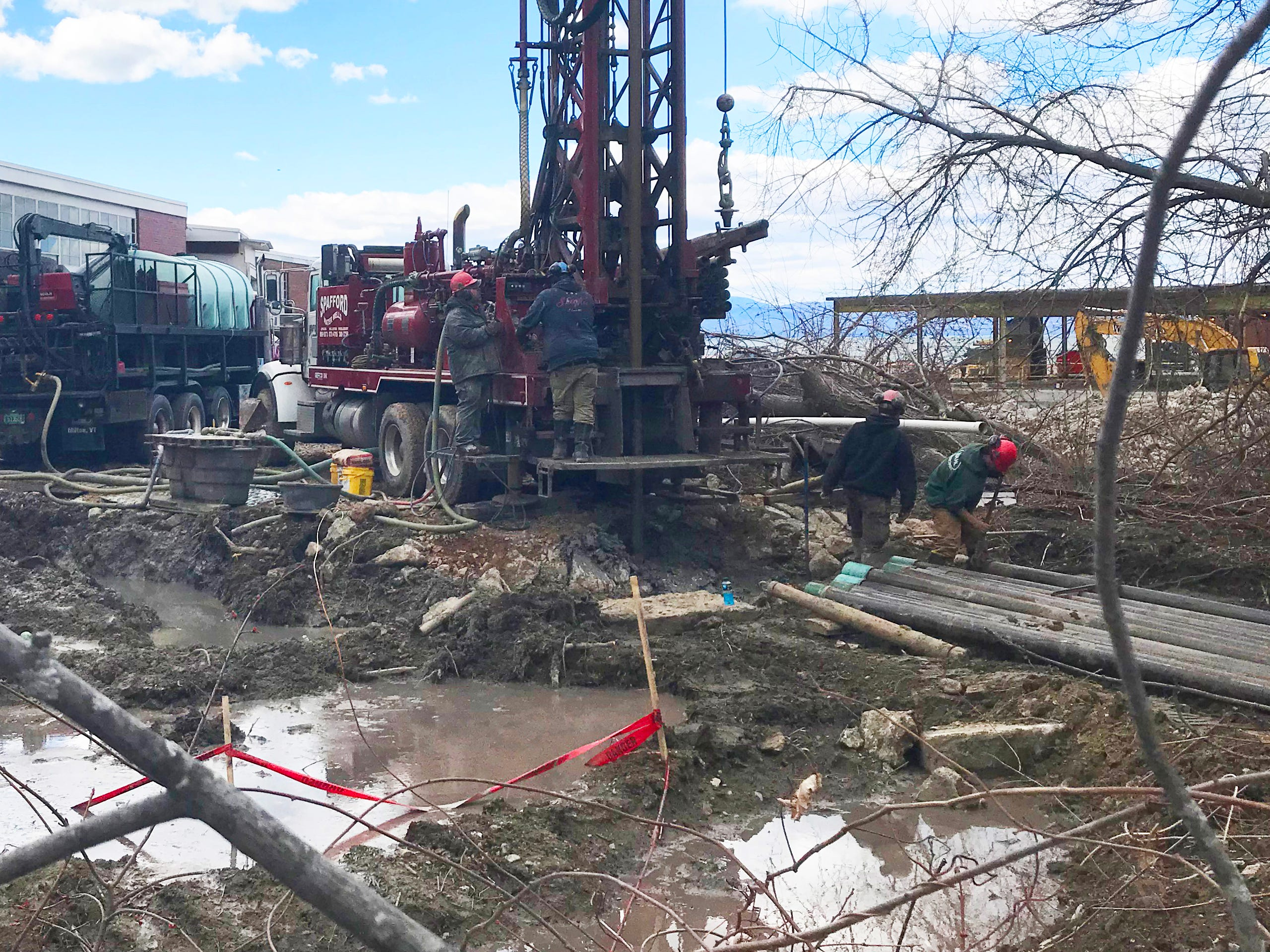 A crew from Spafford & Sons Water Wells operate a drilling rig at Hula Lakeside — the former Blodgett Ovens factory — in Burlington on Tuesday, April 16, 2019.