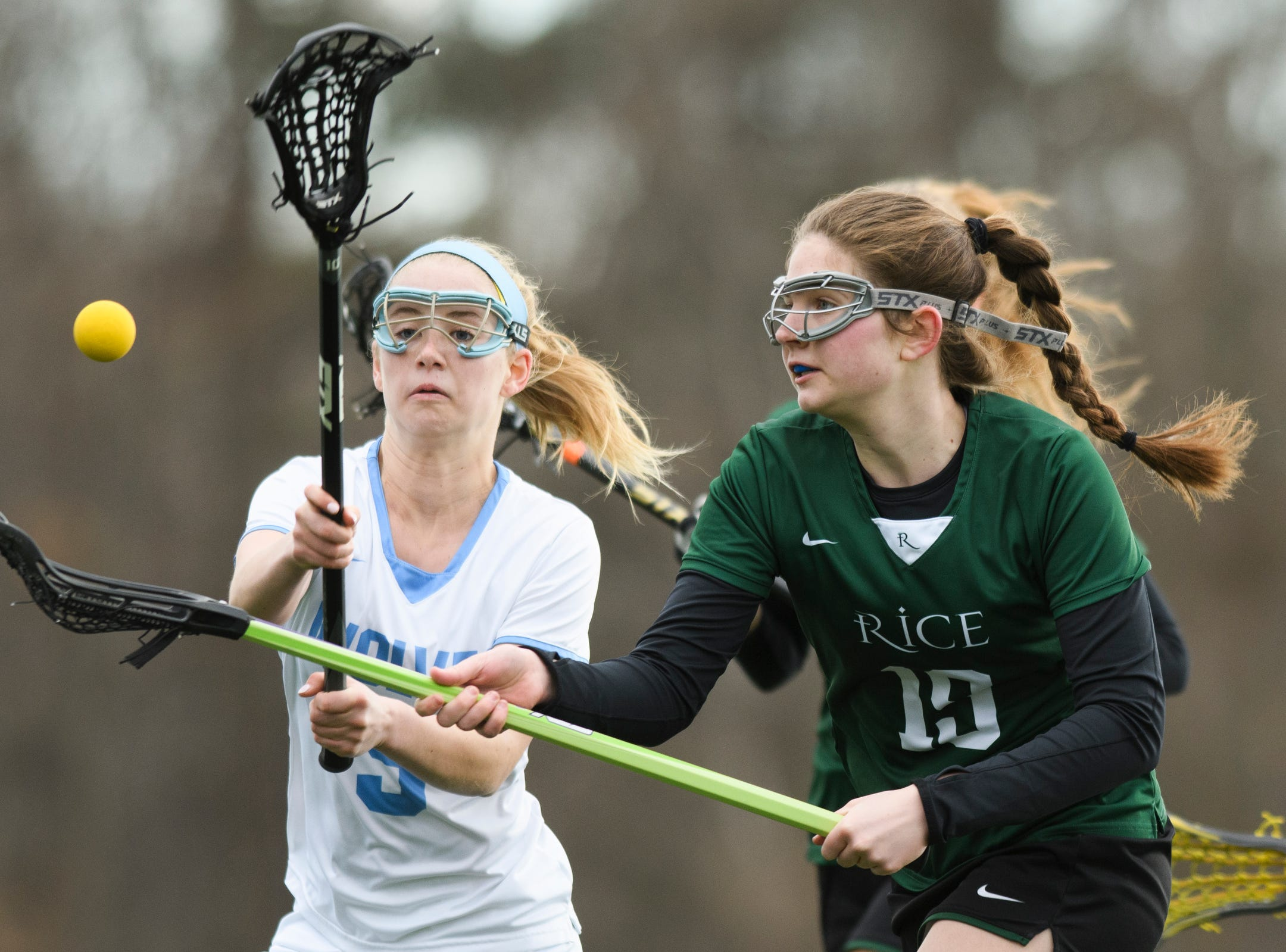 Rice's Sarah Holmes (19) looses the ball as she runs past South Burlington's Kaleigh Plumeau (9) during the girls lacrosse game between the Rice Green Knights and the South Burlington Wolves at South Burlington High School on Tuesday afternoon April 16, 2019 in South Burlington, Vermont.