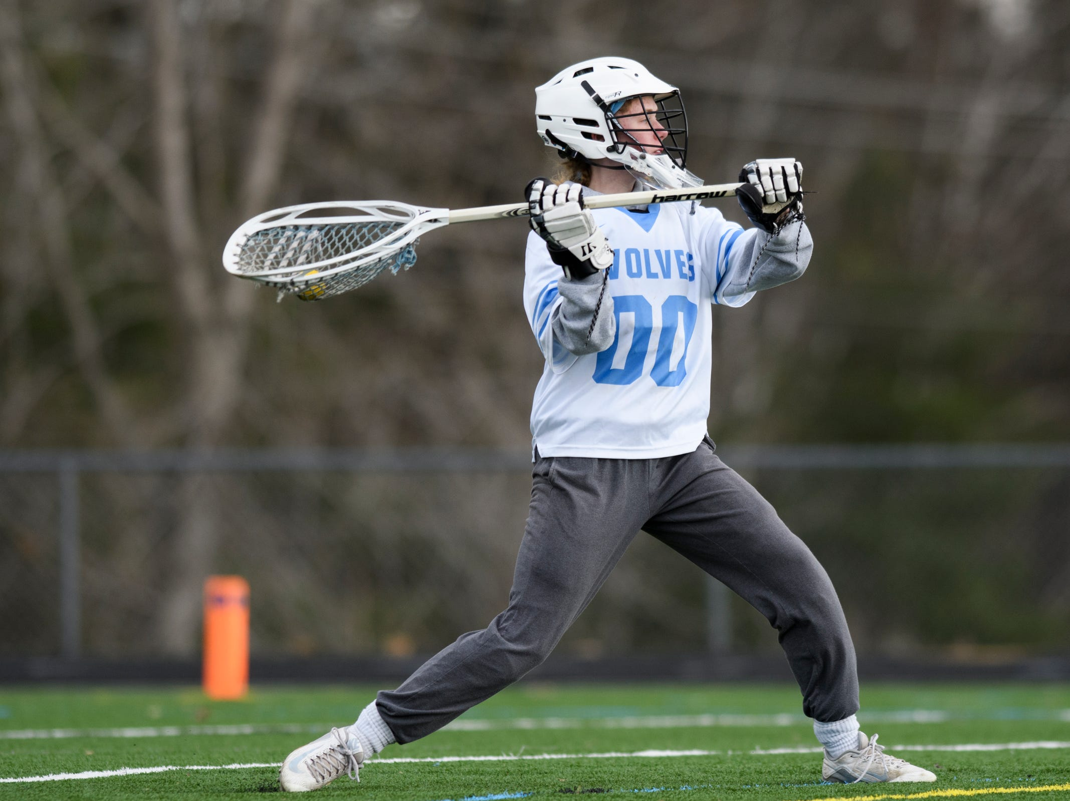 South Burlington goalie Claire Philips (00) passes the ball down the field during the girls lacrosse game between the Rice Green Knights and the South Burlington Wolves at South Burlington High School on Tuesday afternoon April 16, 2019 in South Burlington, Vermont.