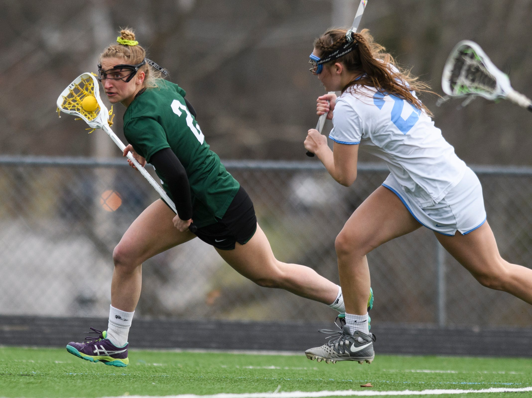 Rice's Lisa McNamara (2) runs down the field with the ball during the girls lacrosse game between the Rice Green Knights and the South Burlington Wolves at South Burlington High School on Tuesday afternoon April 16, 2019 in South Burlington, Vermont.
