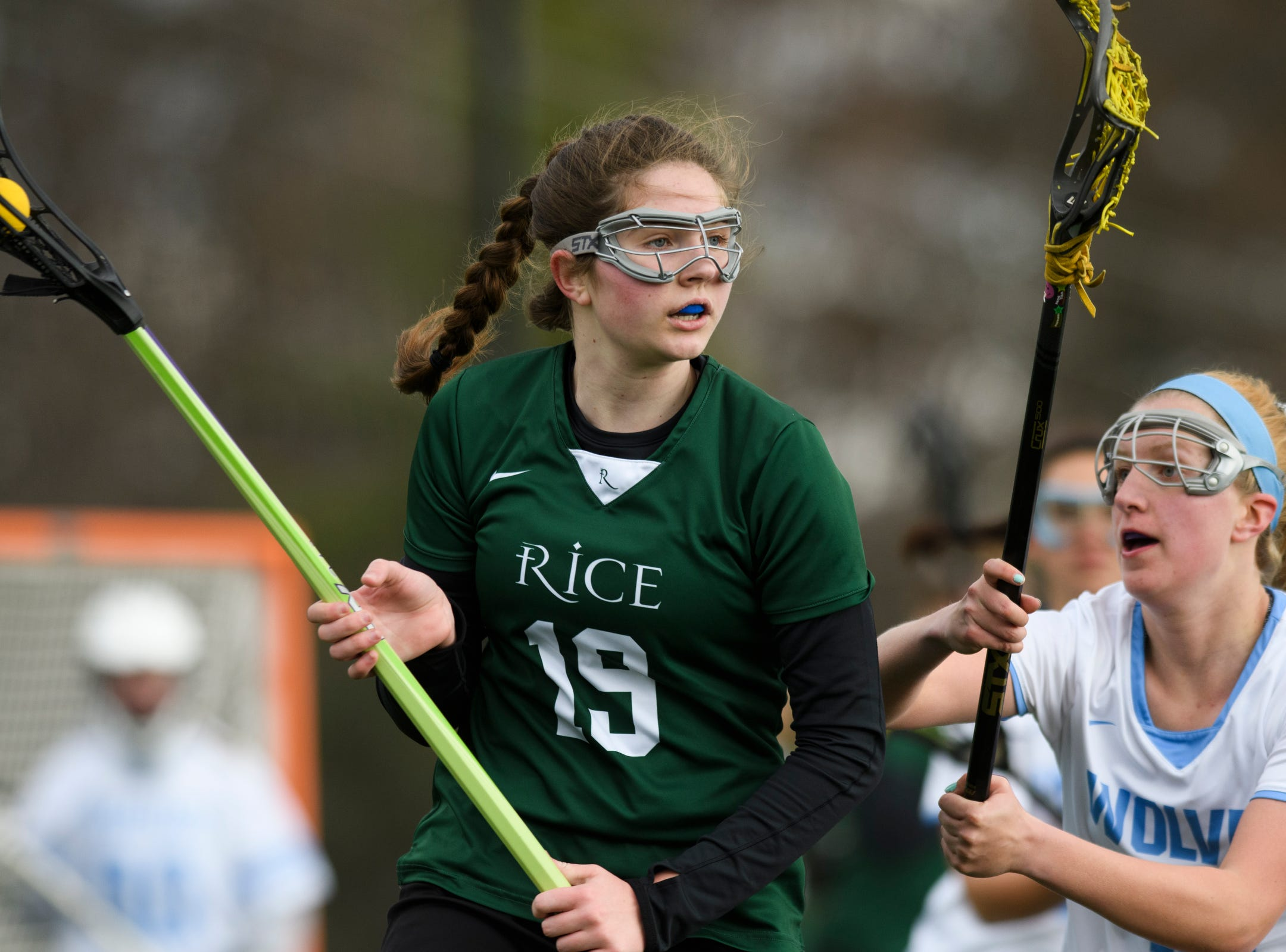 Rice's Sarah Holmes (19) runs with the ball during the girls lacrosse game between the Rice Green Knights and the South Burlington Wolves at South Burlington High School on Tuesday afternoon April 16, 2019 in South Burlington, Vermont.