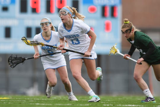 South Burlington's Caroline Desautels (13) runs down the field with the ball during the girls lacrosse game between the Rice Green Knights and the South Burlington Wolves at South Burlington High School on Tuesday afternoon April 16, 2019 in South Burlington, Vermont.