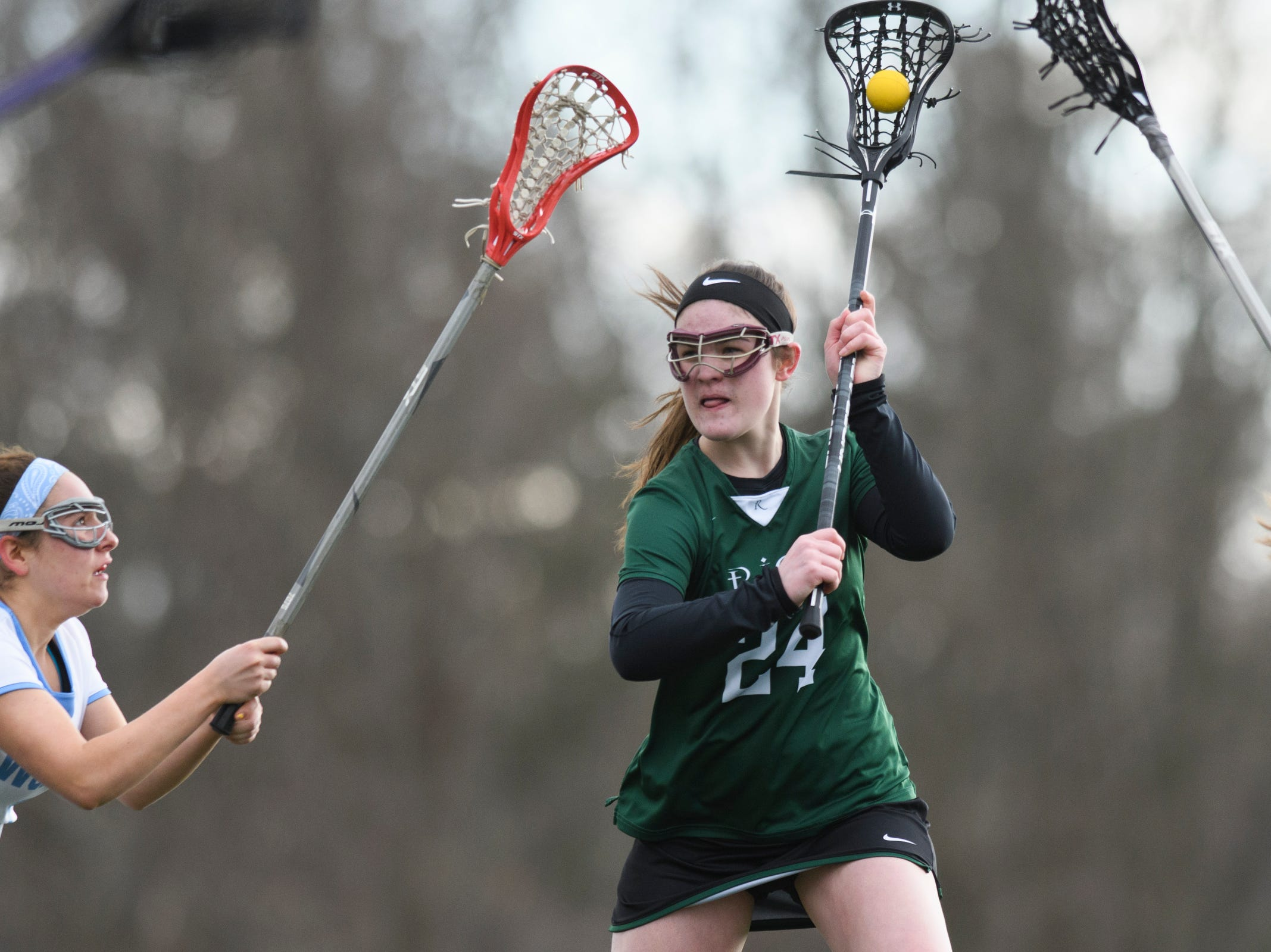 Rice's Annika Hanson (24) looks to shoot the ball during the girls lacrosse game between the Rice Green Knights and the South Burlington Wolves at South Burlington High School on Tuesday afternoon April 16, 2019 in South Burlington, Vermont.