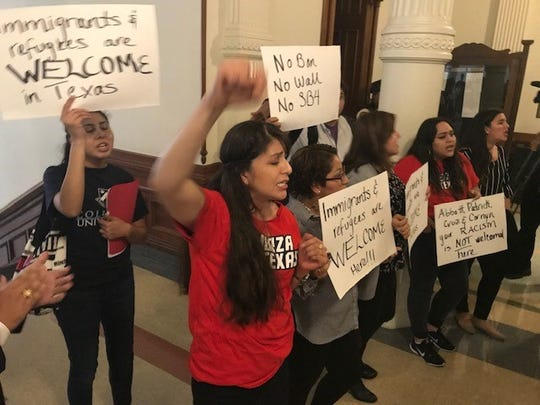 Protesters urge for a more compassionate approach to immigration during a demonstration in the Texas Capitol, April 17, 2019.