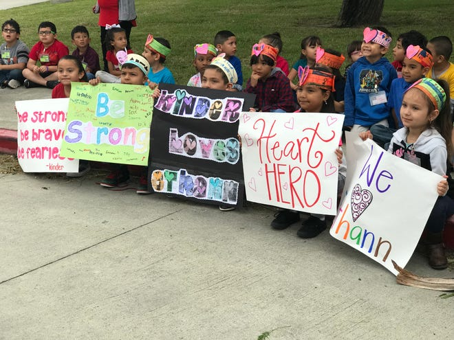 """Kindergarten students from Garcia Elementary in Corpus Christi hold posters during a """"Best Wishes"""" parade for Ethann Valdez on April 17, 2019. The 9-year-old will undergo heart surgery later this month."""