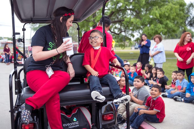 "Janine Hobrecht (left), a pediatric private duty nurse, talks with Ethann Valdez, 9, before a parade begins in his honor at Garcia Elementary School on Wednesday, April 17, 2019. Diagnosed at the age of five with geleophysic dysplasia (known as dwarfism), Ethann will be out of school for the rest of the year as he undergoes open heart surgery for a valve replacement to the main aorta of his heart. The school wanted to send him off with a ""Best Wishes Parade"" before he left."