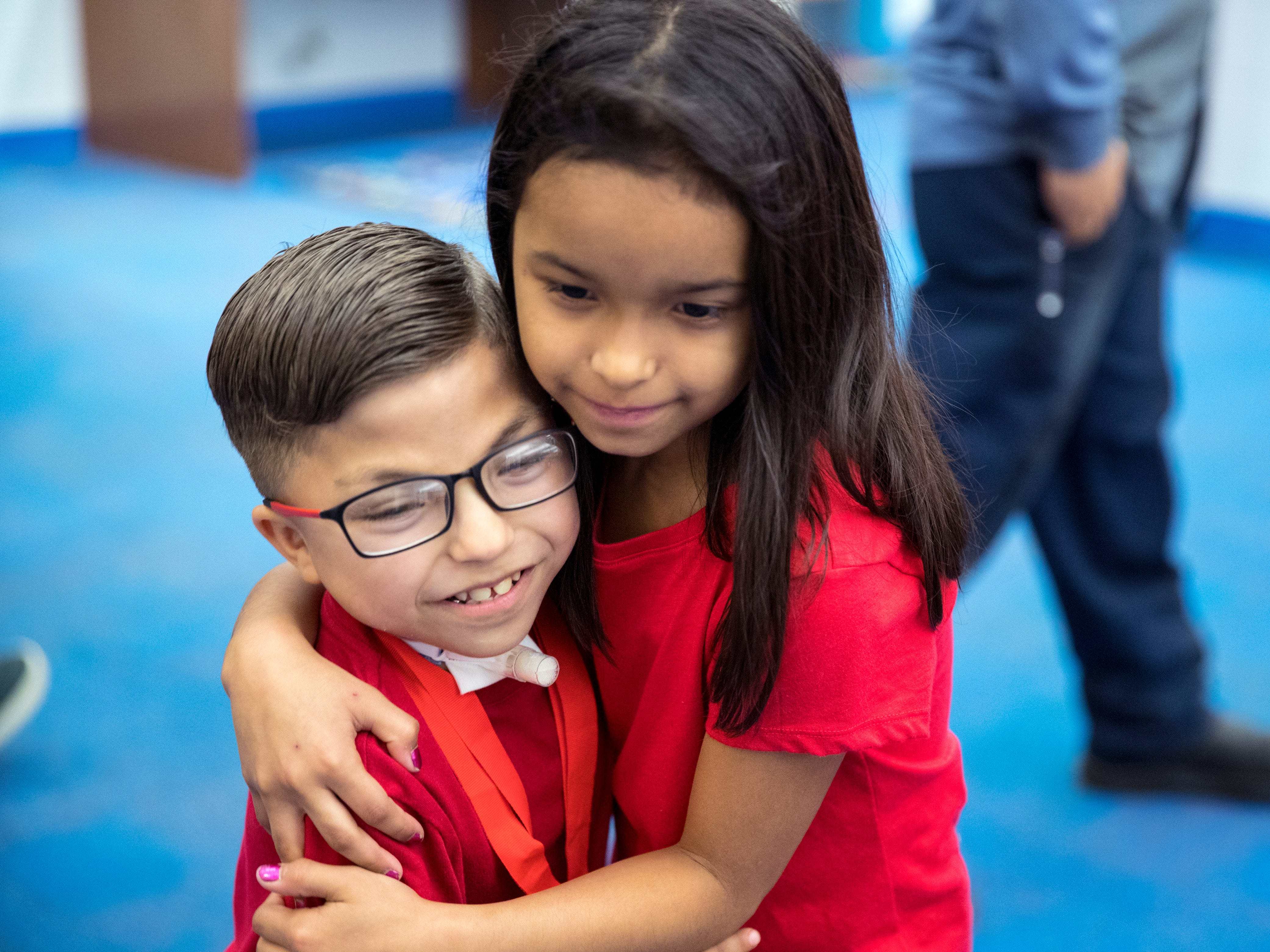 """Ethann Valdez, 9, gets a hug from his sister, Chastity Hernandez, 7, following a """"Best Wishes Parade"""" in his honor at Garcia Elementary School on Wednesday, April 17, 2019. Diagnosed at the age of five with geleophysic dysplasia (known as dwarfism), Ethann will be out of school for the rest of the year as he undergoes open heart surgery for a valve replacement to the main aorta of his heart. The school wanted to send him off with a """"Best Wishes Parade"""" before he left."""