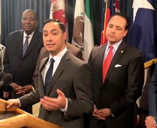 U.S. Rep. Joaquin Castro, D-San Antonio, says Republicans should stand up to President Trump's hardline immigration policies. He is flanked by state Sens. Royce West, left, and Jose Mendendez at the Texas Capitol, April 17, 2019.