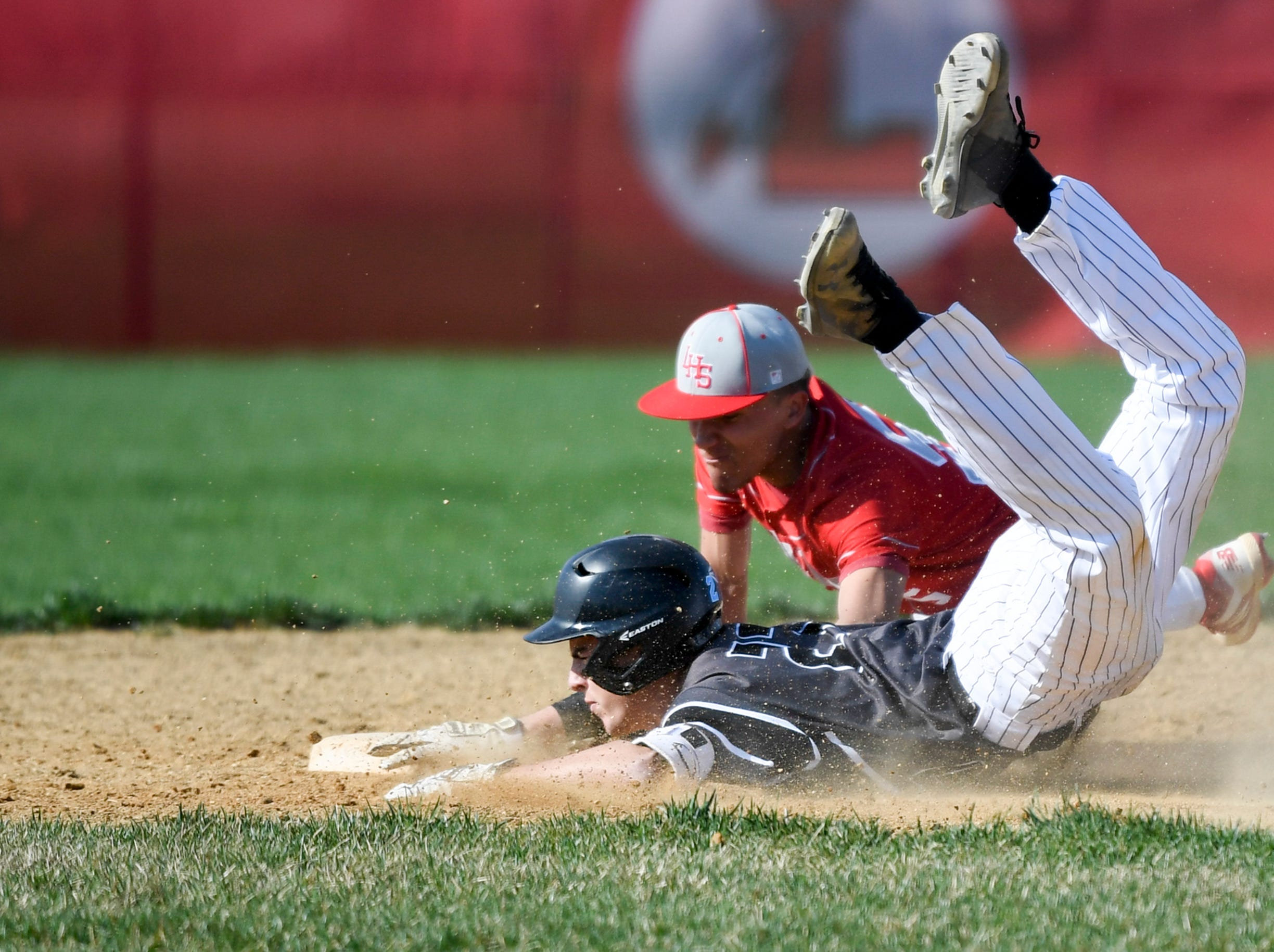 Bishop Eustace's Eric Sabato (27) slides safe into second against Lenape Tuesday, April 16, 2019 in Medford, N.J. Bishop Eustace won 5-3 and head coach Sam Tropiano earned his record-setting 673rd win.