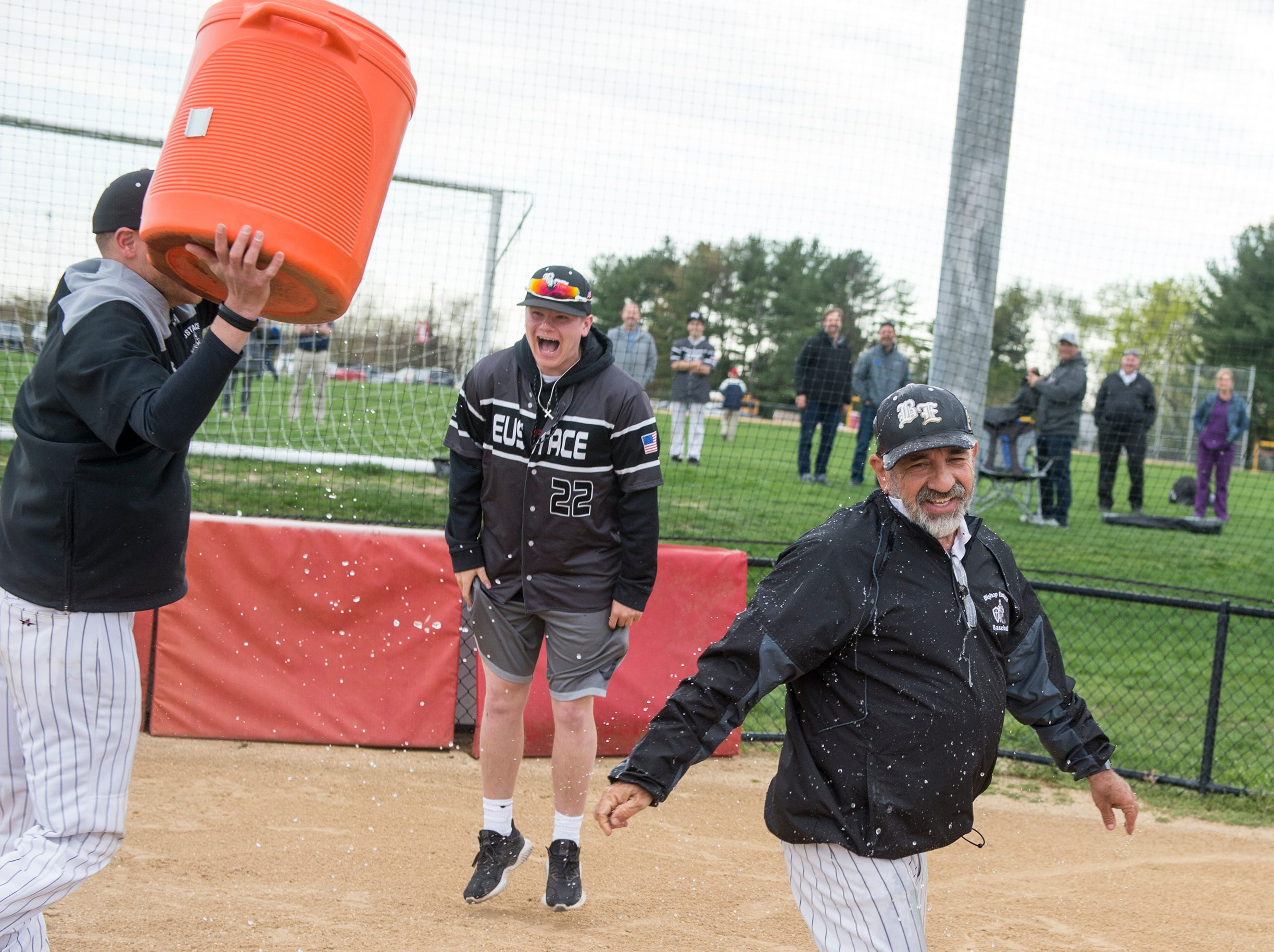 Bishop Eustace head coach Sam Tropiano, right, can't escape the cooler following a 5-3 win over Lenape, earning his 673rd win and a new South Jersey record Tuesday, April 16, 2019 at Lenape High School in Medford, N.J.