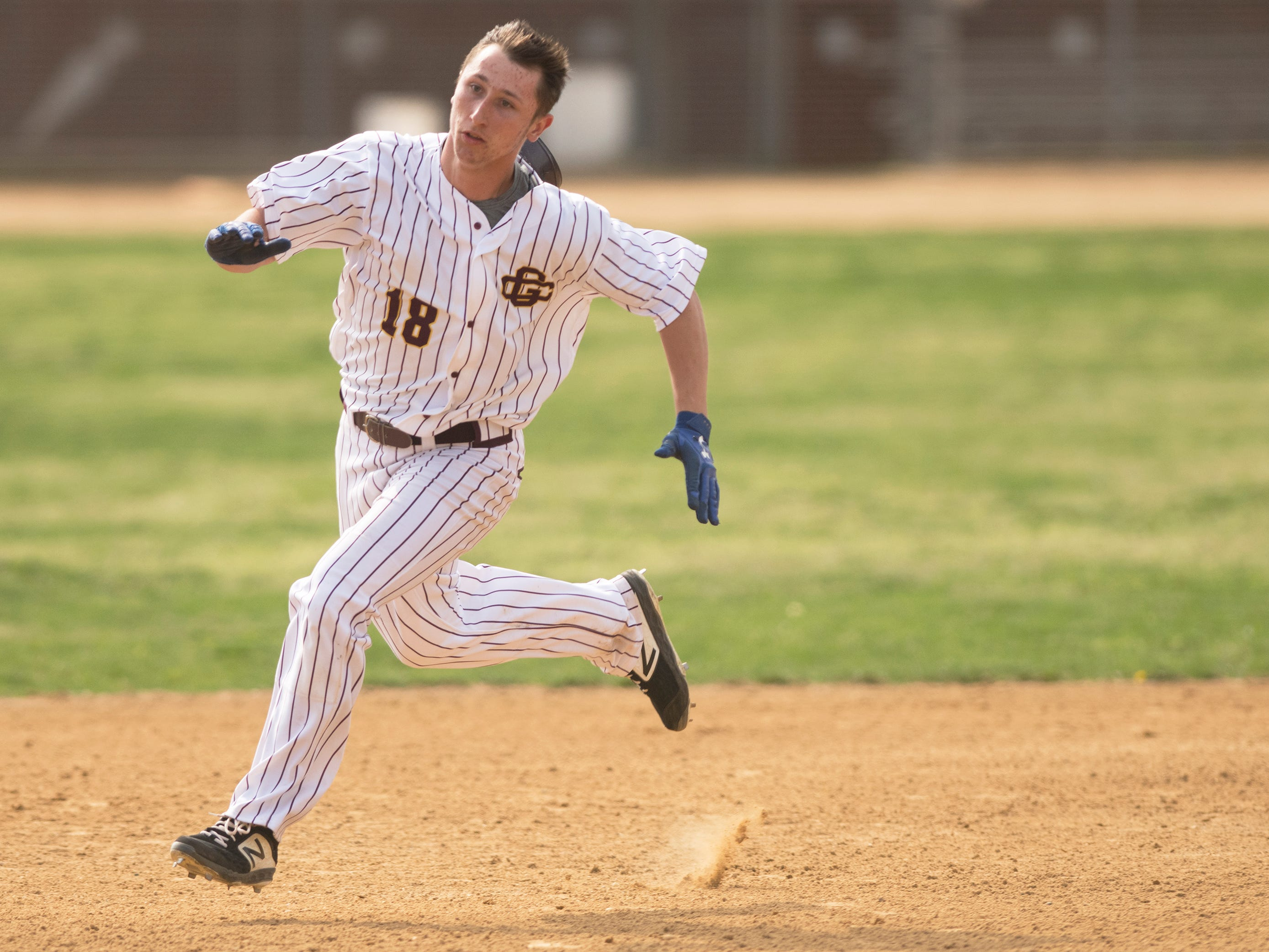Gloucester Catholic's Jake McNellis runs towards third base after hitting a triple during the first inning of Gloucester Catholic's 13- 0 win over Pennsville at Joe Barth Field in Brooklawn on Wednesday, April 17, 2019.