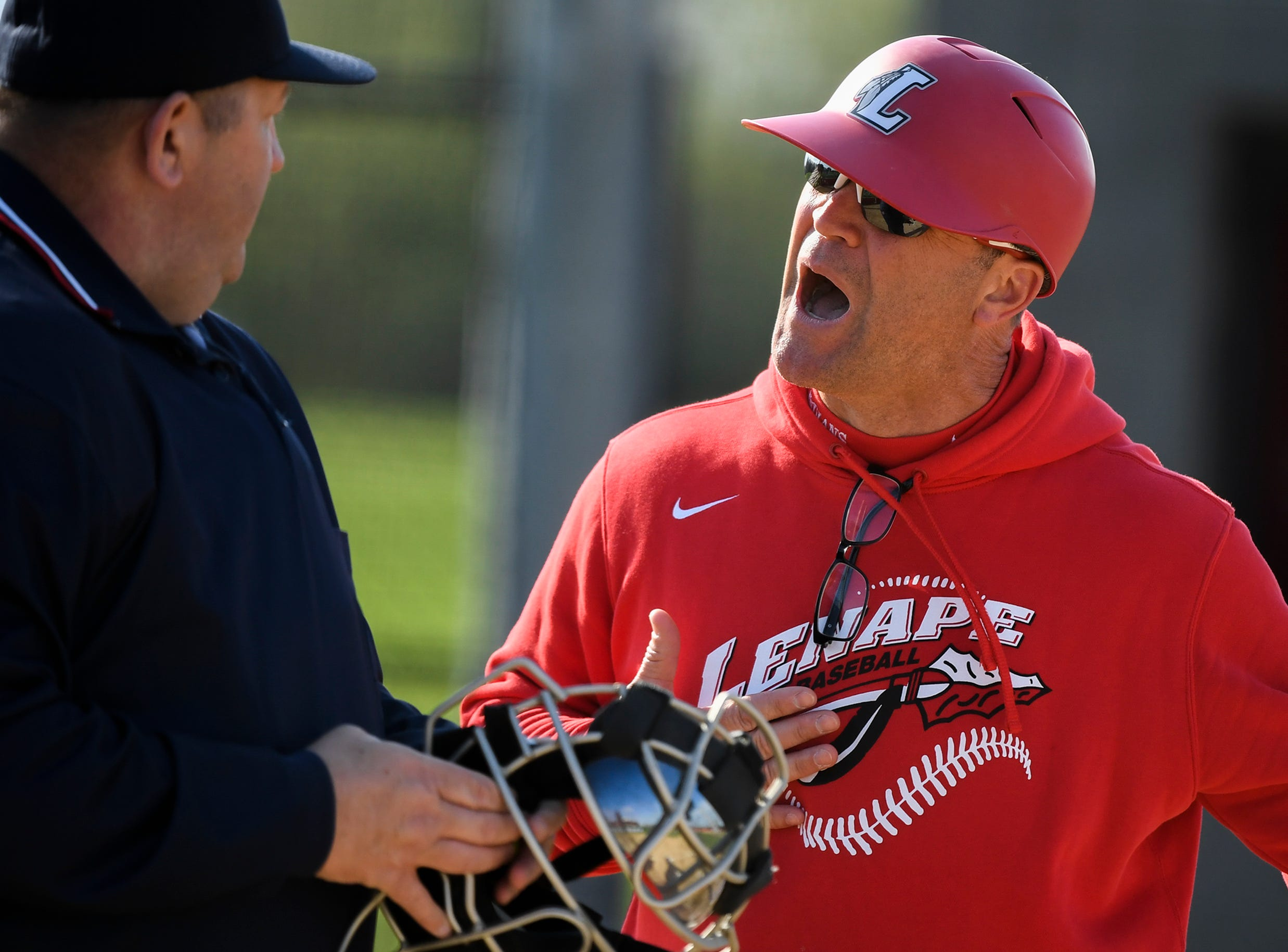 Lenape head coach Phil Fiore argues with an official over a called strike while the batter claimed to be asking for time Tuesday, April 16, 2019 in Medford, N.J. Bishop Eustace won 5-3 and head coach Sam Tropiano earned his record-setting 673rd win.