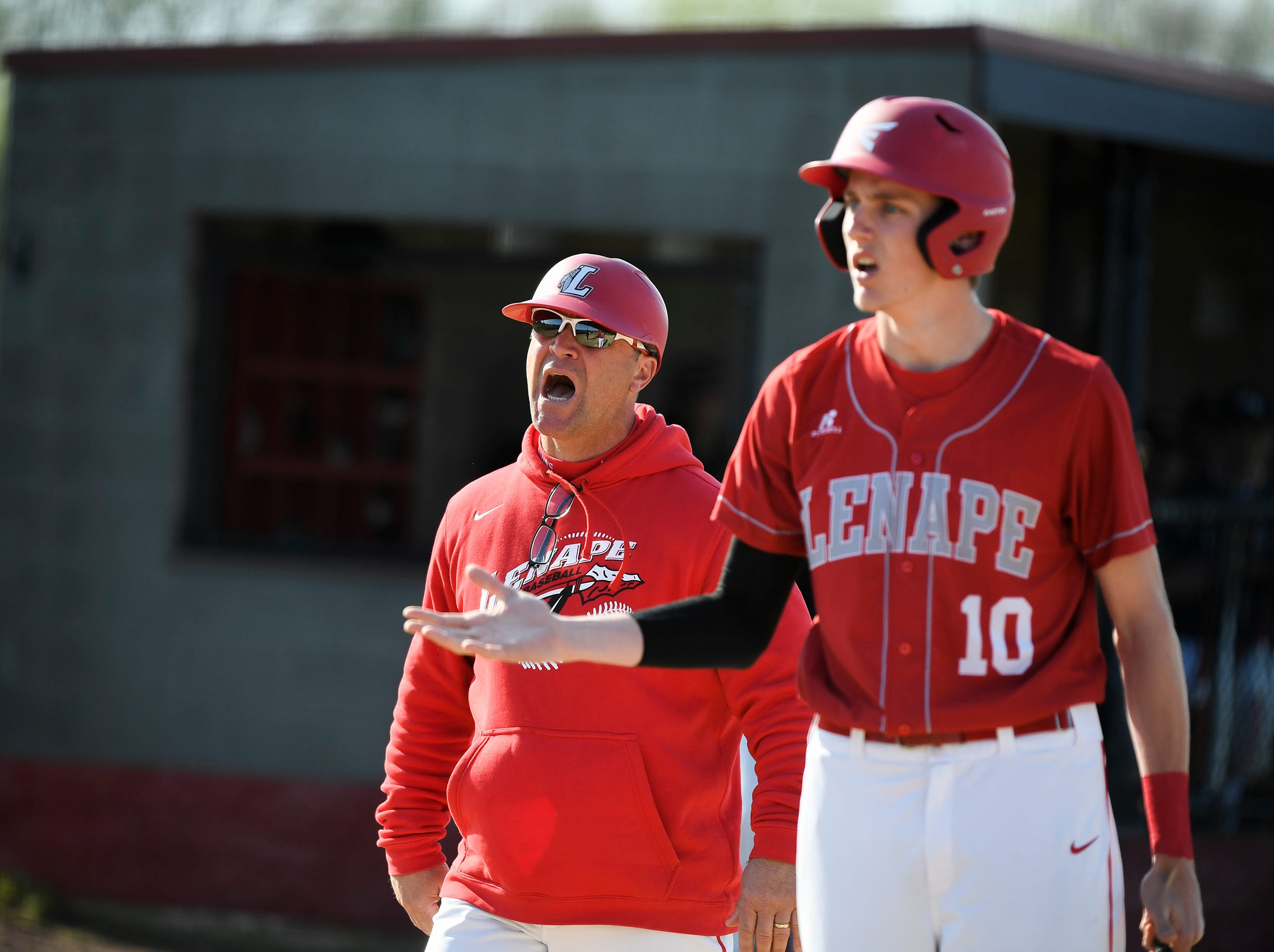 Lenape head coach Phil Fiore and Steve Matlack (10) argue over a called strike while Matlack claimed to be asking for time Tuesday, April 16, 2019 in Medford, N.J. Bishop Eustace won 5-3 and head coach Sam Tropiano earned his record-setting 673rd win.