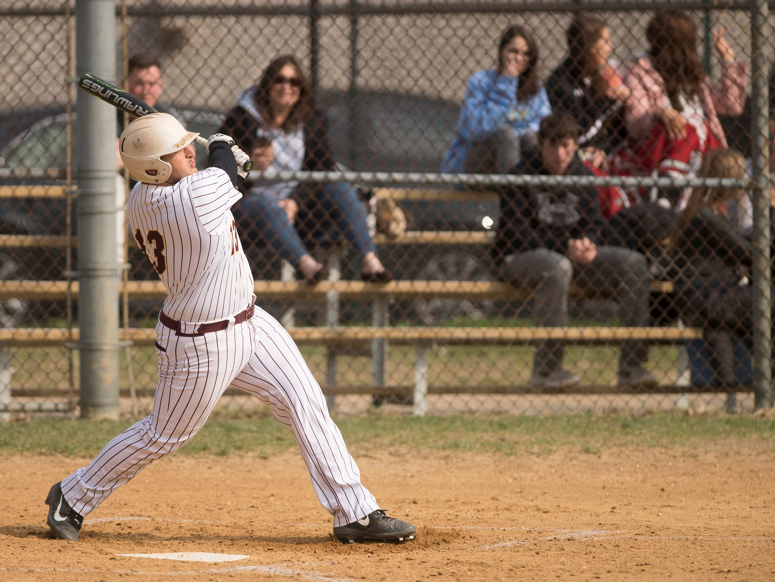 Gloucester Catholic's Lillo Paxia connects for an RBI single during the first inning of Gloucester Catholic's 13- 0 win over Pennsville at Joe Barth Field in Brooklawn on Wednesday, April 17, 2019.