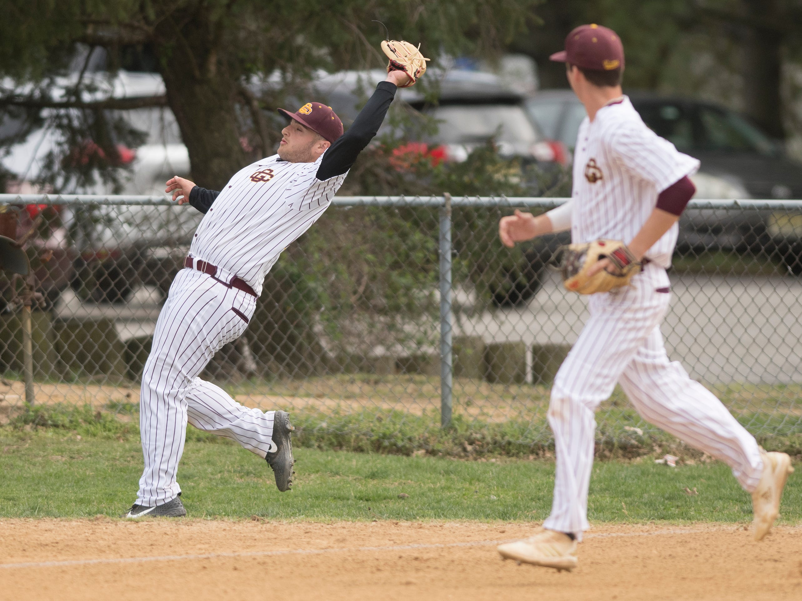 Gloucester Catholic's Lillo Paxia catches a foul ball during Gloucester Catholic's 13- 0 win over Pennsville at Joe Barth Field in Brooklawn on Wednesday, April 17, 2019.