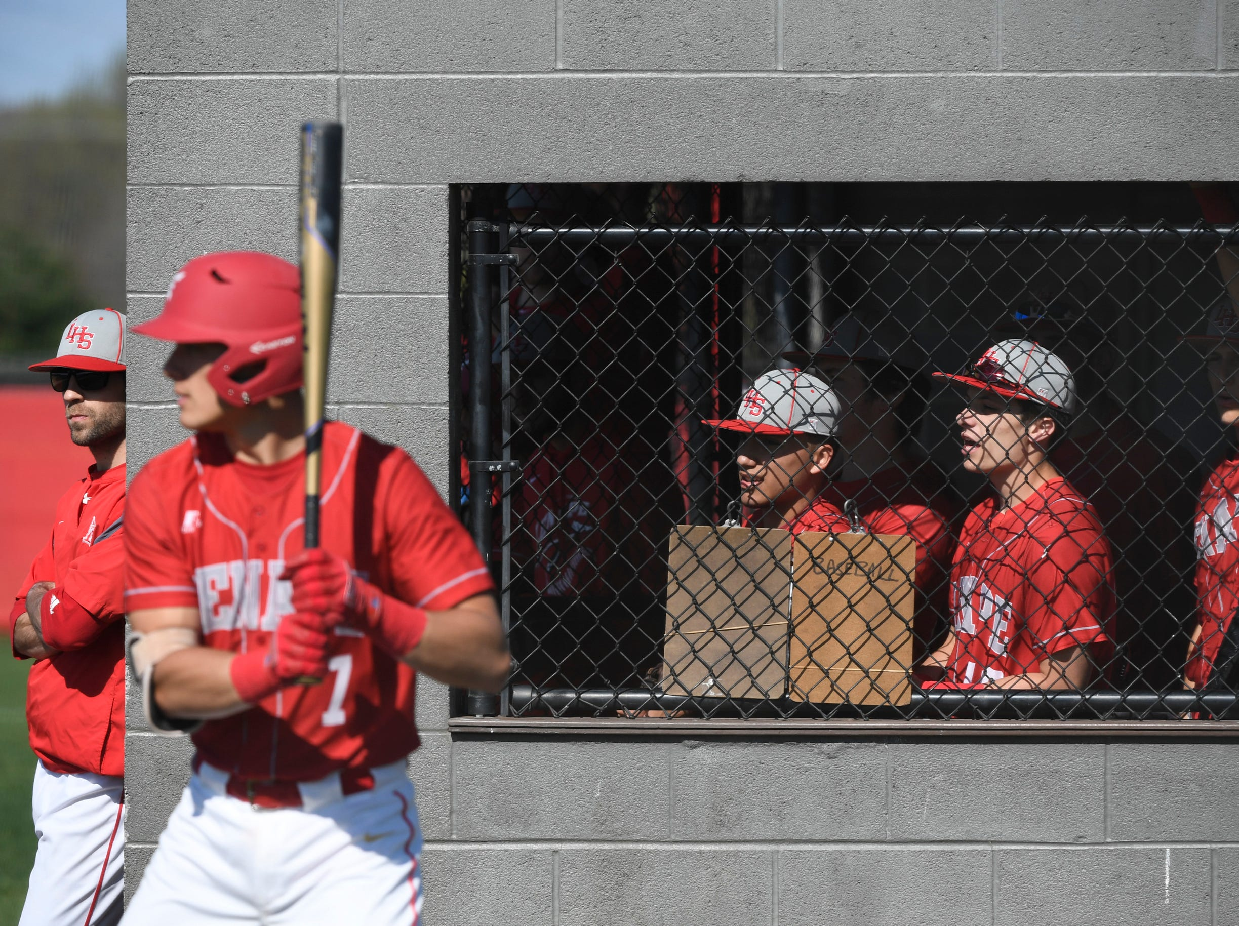 The Lenape dugout cheers on their team during a game against Bishop Eustace Tuesday, April 16, 2019 in Medford, N.J. Bishop Eustace won 5-3 and head coach Sam Tropiano earned his record-setting 673rd win.