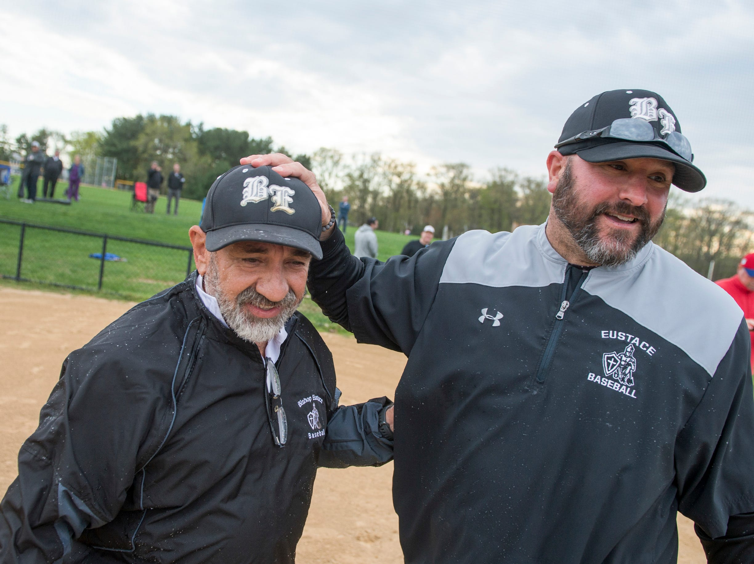 Bishop Eustace head coach Sam Tropiano, left, is congratulated by assistant coach Nick DelGozzo following a 5-3 win over Lenape, earning his 673rd win and a new South Jersey record Tuesday, April 16, 2019 at Lenape High School in Medford, N.J.