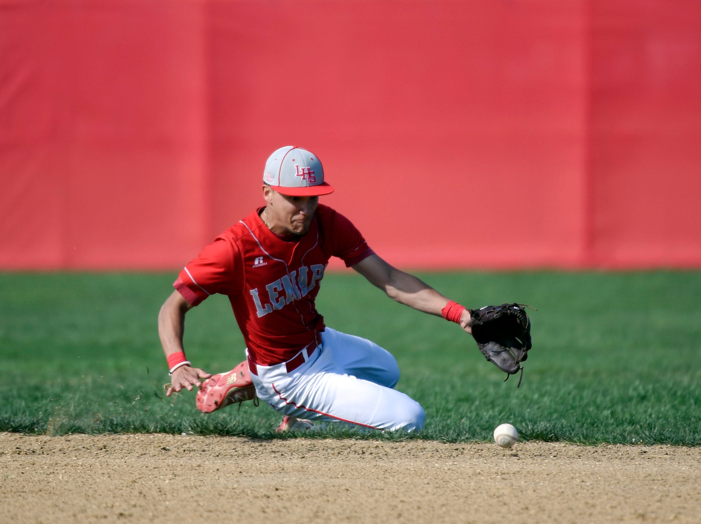 Lenape's Edwin Gonzalez (5) fields a grounder against Bishop Eustace Tuesday, April 16, 2019 in Medford, N.J. Bishop Eustace won 5-3 and head coach Sam Tropiano earned his record-setting 673rd win.