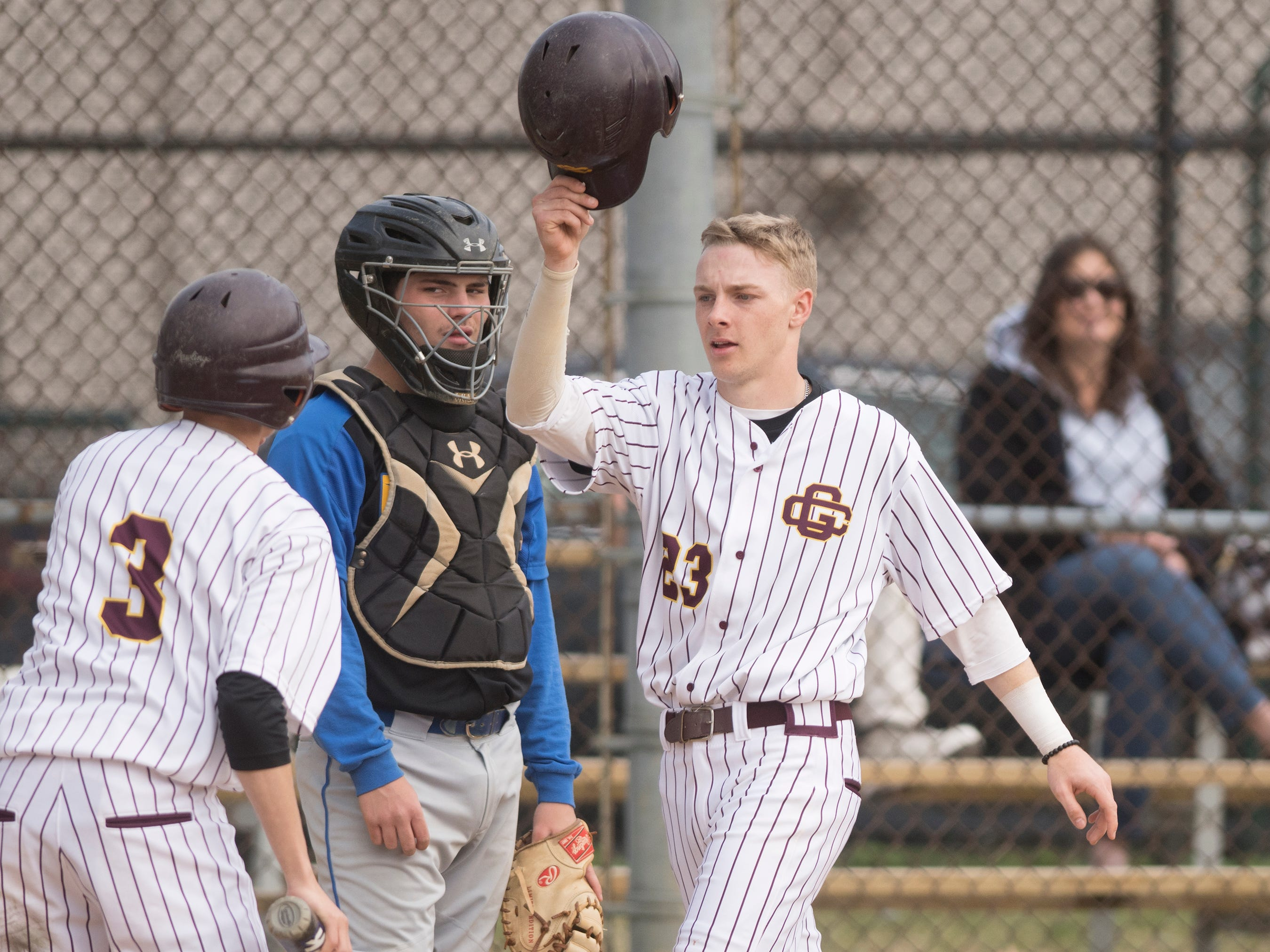Gloucester Catholic's Tyler Cannon, right, celebrates after scoring a run during Gloucester Catholic's 13- 0 win over Pennsville at Joe Barth Field in Brooklawn on Wednesday, April 17, 2019.