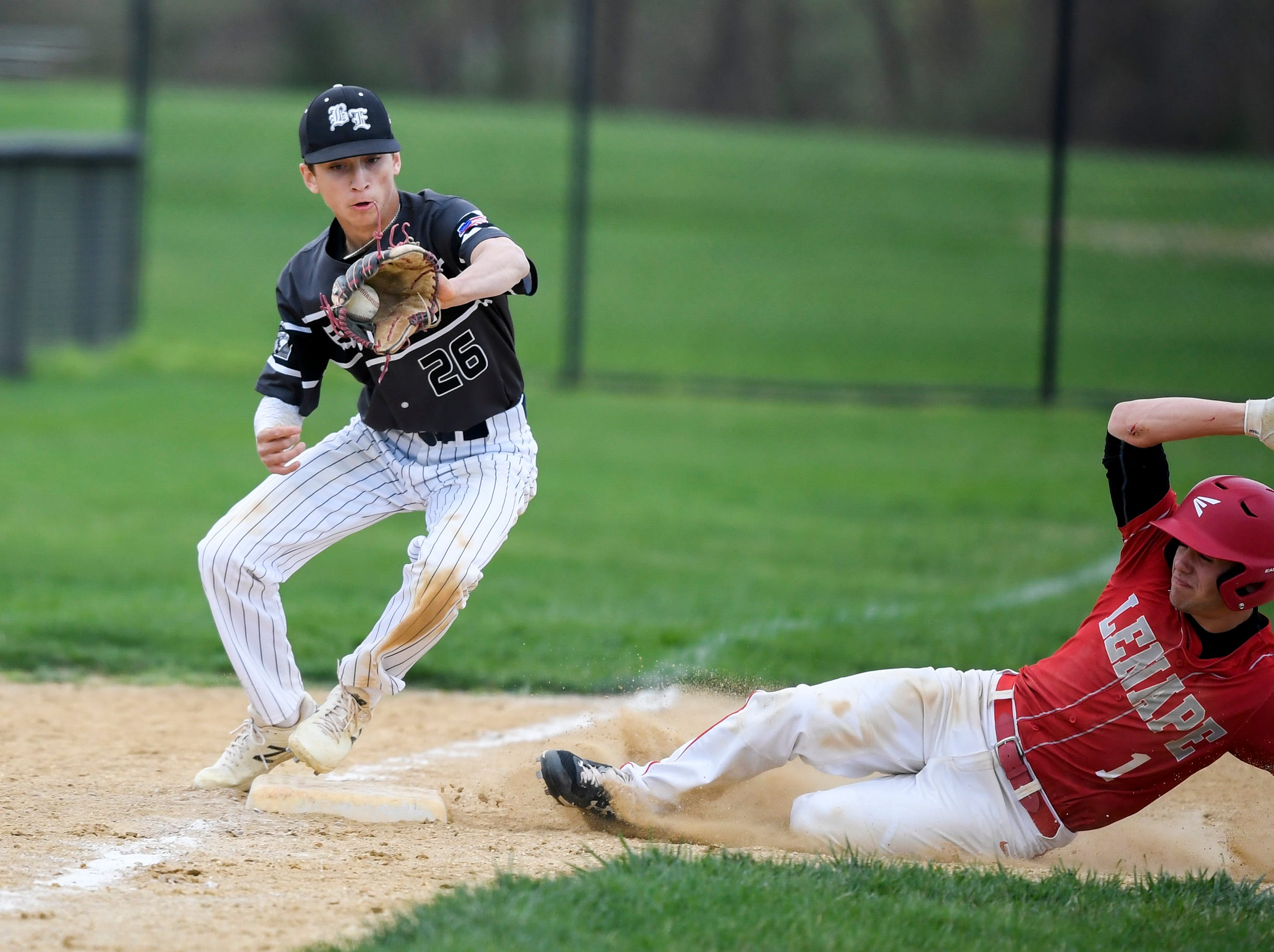 Lenape's Joey Pence (1) slides safe into third as Bishop Eustace's Daniel Obermeier (26) attempts the out Tuesday, April 16, 2019 in Medford, N.J. Bishop Eustace won 5-3 and head coach Sam Tropiano earned his record-setting 673rd win.