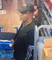 Washington Township police released this surveillance photo to identify Norman Minor, a resident who had dropped $2,500 in a Walmart store.