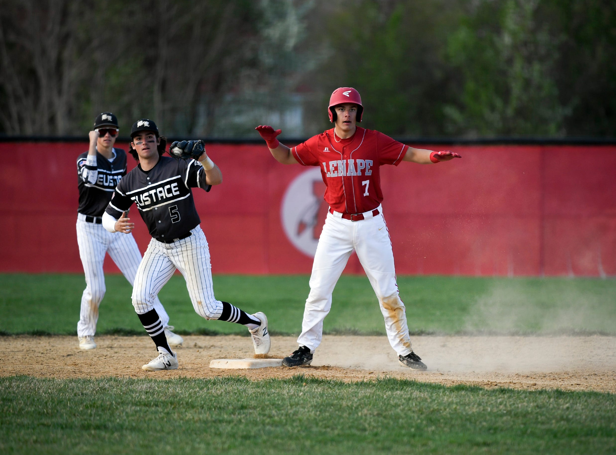 Lenape's Cade Hunter (7) is called out at second by Bishop Eustace's Matt Orlando (5) Tuesday, April 16, 2019 in Medford, N.J. Bishop Eustace won 5-3 and head coach Sam Tropiano earned his record-setting 673rd win.
