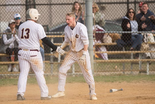 Gloucester Catholic's Tyler Cannon, right, celebrates with Gloucester Catholic's Lillo Paxia after Cannon hit an inside-the-park, 3-run home run during the  bottom of the fourth inning of Gloucester Catholic's 13- 0 win over Pennsville at Joe Barth Field in Brooklawn on Wednesday, April 17, 2019.