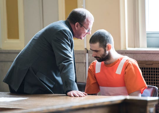 Casey Pigge talks with his lawyer  Gene Meadows shortly after pleading guilty to attempted aggravated murder Wednesday in Scioto County Common Pleas Judge Howard Harcha's courtroom in Portsmouth, Ohio, on April 17, 2019.