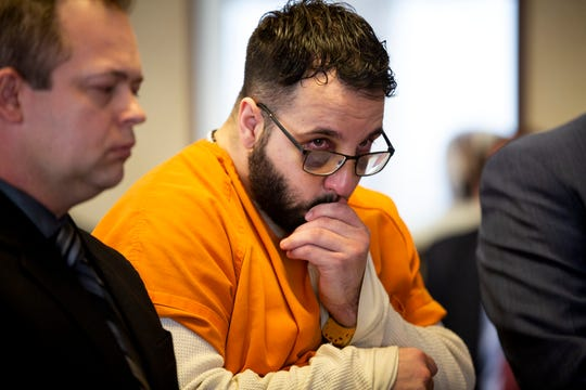 "Michael Strouse listens to his grandmother Rhonda Strouse address Butler County Common Pleas Judge J. Gregory Howard before he sentences Strouse for crimes that include murder and stalking of Ellen ""Ellie"" Weik Wednesday, April 17, 2019 in Butler County Court in Hamilton."