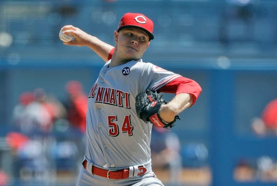Cincinnati Reds starting pitcher Sonny Gray throws to the Los Angeles Dodgers during the first inning of a baseball game Wednesday, April 17, 2019, in Los Angeles.