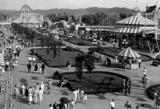 Fun-seekers stroll the mall at Coney Island in 1928.