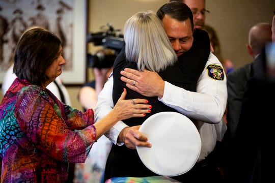 Laura Weik embraces West Chester Police Chief Joel Herzog near her mother Tam Weik after Michael Strouse, who pleaded guilty to the murder of Ellie Weik, was sentenced 15 years to life for the murder of Weik Wednesday, April 17, 2019 in Butler County Court in Hamilton. Strouse also received 18 months for stalking and 12 months for abuse of a corpse. The sentences will run consecutively.