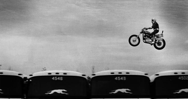 OCTOBER 25, 1975: Evel Knievel soars over 14 Greyhound buses in the longest jump of his career.