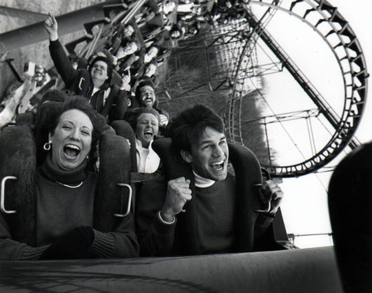 1988: The first riders on Kings Island's new steel roller coaster, Vortex, are exuberant here as they come out of the corkscrew turn. All of the riders are employees of the park. Vortex will open Saturday, April 11, 1988. Kings Island publicity photo scanned August 6, 2010