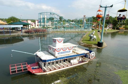 The Belle of LeSourdsville paddlewheel heads out into LeSourdsville Lake underneath the Sky Rider during the re-opening of LeSourdsville Lake Amusement Park, June 7, 2002.
