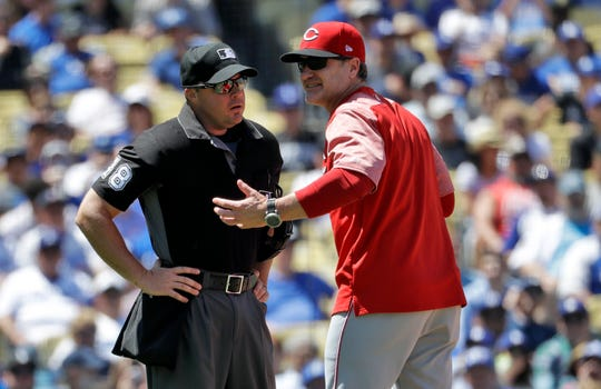 Cincinnati Reds manager David Bell, right, argues with home plate umpire Nick Mahrley after being tossed during the fifth inning of a baseball game against the Los Angeles Dodgers Wednesday, April 17, 2019, in Los Angeles.