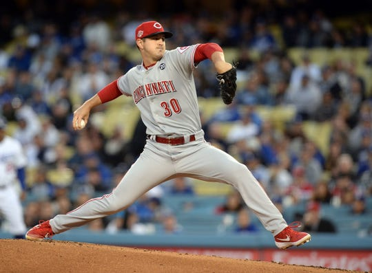 April 16, 2019; Los Angeles, CA, USA; Cincinnati Reds starting pitcher Tyler Mahle (30) throws against the Los Angeles Dodgers during the first inning at Dodger Stadium. Mandatory Credit: Gary A. Vasquez-USA TODAY Sports