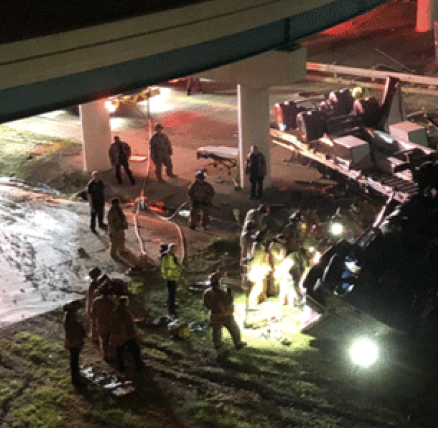 Semi hauling gravel flips off overpass, critically injuring 2 near Downtown