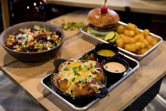 Pull-apart bread, center with other food selections from Miami River Brewhouse, Kings Island's new restaurant photographed Wednesday, April 17, 2019.