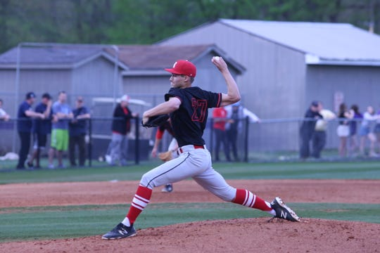 Rossview's Gage Bradley, a Vanderbilt commit, throws the ball toward home plate against Clarksville High Tuesday, April 16, 2019.