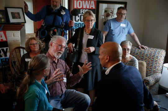 Democratic presidential candidate Cory Booker answers questions during a meeting with supporters at a home in Nevada, Iowa, on Tuesday, April 16, 2019.