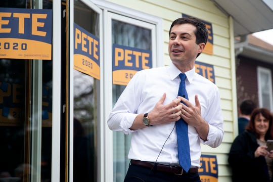 Pete Buttigieg, mayor of South Bend, Ind., speaks to a crowd of people from the back porch of a home on Wednesday, April 17, 2019, in Marshalltown. This is Buttigieg's first trip to Iowa after announcing his 2020 campaign.