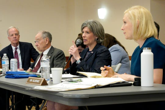 Senators from left: Jerry Moran, R-Kan, Chuck Grassley, R-Iowa, Joni Ernst, R-Iowa and Sen. Kirsten Gillibrand, D-N.Y., are seen during a field hearing of the Senate Committee on Environment and Public Works, in Glenwood, Iowa, Wednesday, April 17, 2019. The hearing was called to investigate the U.S. Army Corps of Engineers' Management of the 2019 Missouri River Basin Flooding. (AP Photo/Nati Harnik)